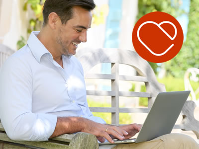 mature man looking for love online using a laptop